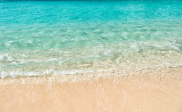 Beautiful marine view on sea coast line with clean wavy surf water on sandy beach Stock Photos