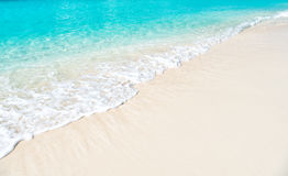 Beautiful marine view on sea coast line with clean wavy surf water on sandy beach Royalty Free Stock Photos