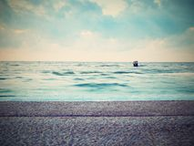 Beautiful marine view on sea coast line with smooth  water over  sandy beach Stock Images