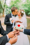 Beautiful married couple attaching to face paper mustache, glasses, bow Royalty Free Stock Images