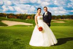Beautiful married couple on golf field Stock Photo