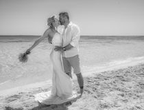 Beautiful married couple on a tropical beach wedding day Stock Image