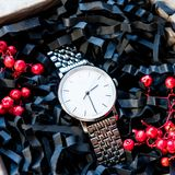 Beautiful masculine gifts, watches in beautiful packaging / craft gifts for him and bright filling, gift clocks Royalty Free Stock Photo