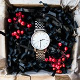Beautiful masculine gifts, watches in beautiful packaging / craft gifts for him and bright filling, gift clocks Royalty Free Stock Photos