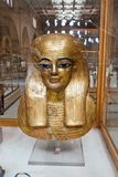 Beautiful. A beautiful mask of an Egyptian woman with a beautiful golden color that shines everything inside the Egyptian museum in cairo Royalty Free Stock Images