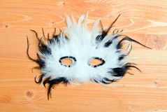 Beautiful mask of feathers on a yellow board Stock Photography