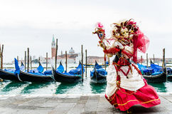 Beautiful mask with gondolas. Venice at carnival, a beautiful mask with gondolas in the background Stock Photos
