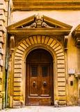 Beautiful massive wooden door in Florence Stock Photos