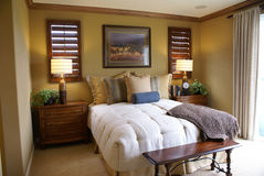 Beautiful Master Bed Room. With wood shudders and crown molding Stock Image