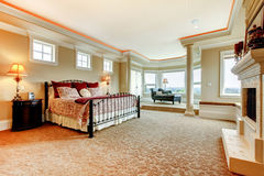 Beautiful master bedroom with elegant bedding and a glass door. Royalty Free Stock Photos