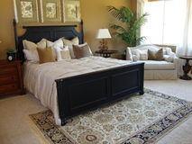 Beautiful Master Bedroom Suite. Beautiful luxury master bedroom suite with a sitting area Stock Images