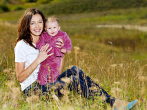 Beautiful mather with smiling beby on nature Stock Photo