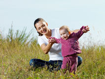 Beautiful mather with smiling beby on nature Royalty Free Stock Photo