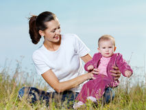 Beautiful mather with smiling beby on nature Royalty Free Stock Images