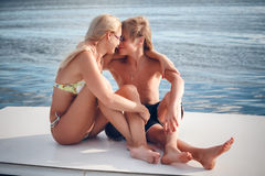 Beautiful mather with son by the boat Royalty Free Stock Image
