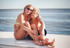 Beautiful mather with son by the boat. Young beautiful mather with son by the boat Stock Photos