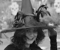 Beautiful mature brunette witch black and white stock photography