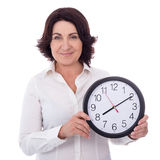 Beautiful mature business woman holding office clock isolated on Royalty Free Stock Photography