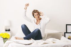Beautiful mature business woman listening music with headphones. Break time. Royalty Free Stock Photos
