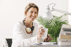 Beautiful mature business woman working on desk. Royalty Free Stock Images