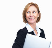 Beautiful mature businesswoman holding laptop Royalty Free Stock Photos