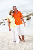 Beautiful mature couple on the beach stock images