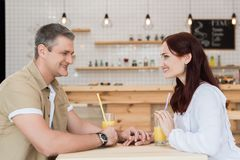 Date. Beautiful mature couple having date in cafe royalty free stock photos