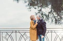 Beautiful mature couple standing near lake stock image
