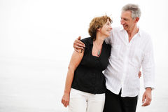 Beautiful mature couple taking a romantic walk stock photography