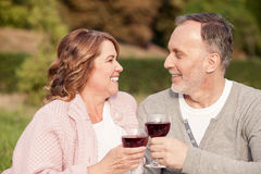 Beautiful mature husband and wife are making Stock Photos