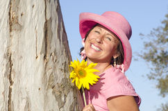 Beautiful mature lady with sunflower Royalty Free Stock Photography