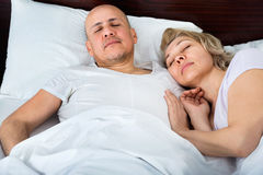 Beautiful mature man and woman taking. Beautiful mature men and women taking a nap together Royalty Free Stock Image