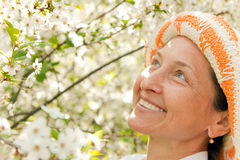 Beautiful mature woman. Portrait of beautiful mature woman in spring garden royalty free stock photography