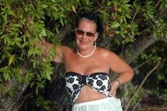 Beautiful mature Woman. With sunglasses on Caribbean beach Stock Photos