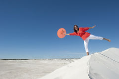 Beautiful mature woman balancing on sand dune Royalty Free Stock Photo