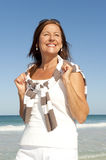 Beautiful mature woman beach holiday isolated Stock Photography