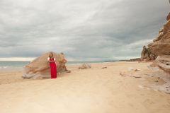 Beautiful mature woman at beach and storm clouds Royalty Free Stock Image