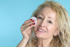 Beautiful mature woman cleaning her face Stock Photos