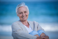 Beautiful mature woman day dreaming. On the beach royalty free stock photos