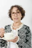 Beautiful mature woman drinking tea Royalty Free Stock Photos