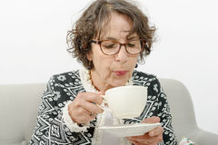 Beautiful mature woman drinking tea Royalty Free Stock Images