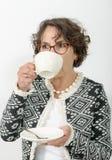 Beautiful mature woman drinking tea Royalty Free Stock Image