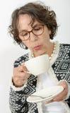 Beautiful mature woman drinking tea Stock Photos