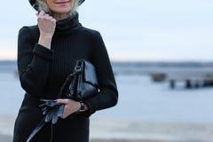 Beautiful mature woman. On embankment Royalty Free Stock Photos