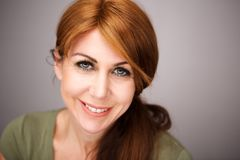 Beautiful mature woman face stock photos