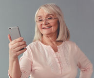 Beautiful mature woman with gadget Royalty Free Stock Photo
