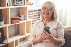 Beautiful mature woman with gadget Royalty Free Stock Image