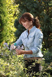 Beautiful mature woman gardening Stock Photo