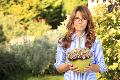 Beautiful mature woman gardening Royalty Free Stock Photo