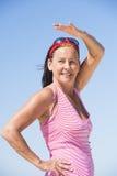 Beautiful mature woman happy at beach holiday Stock Image